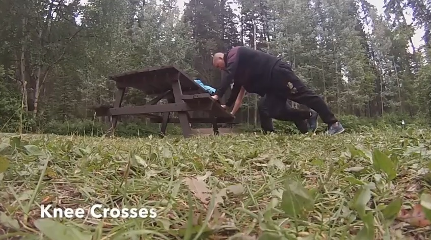 knee crosses exercise while camping