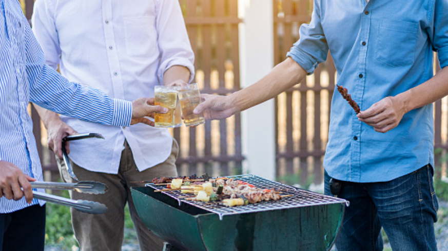 Men having BBQ and beer