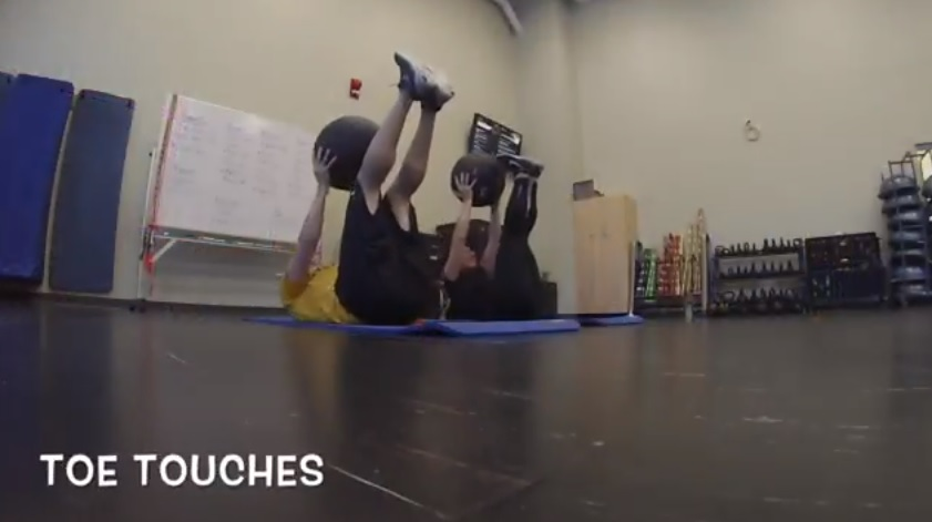 toe touches medicine ball exercise